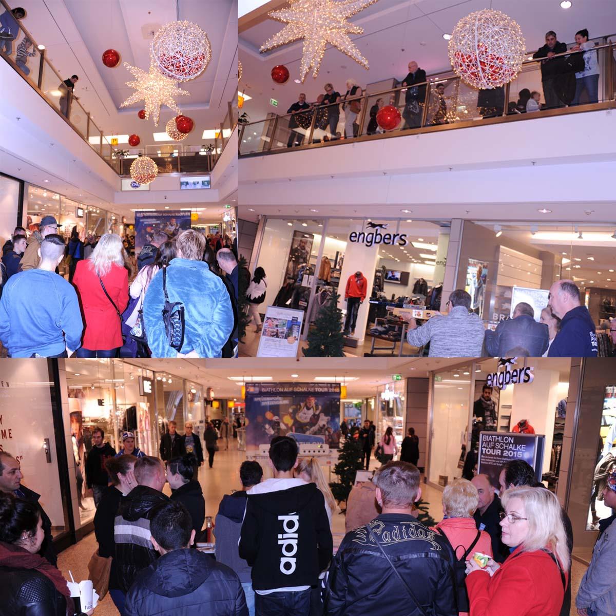 """Als wir am Morgen des 2. Etappentages das Stern-Center betreten, erstrahlt dieses im herrlichen Weihnachtskleid. Nach ersten Weihnachtseinkäufen scheint auch den Besuchern zu behagen, denn nicht weniger als 30.000 strömten an diesem Samstag lt. Centermanagement durch das Einkaufszentrum. Darunter viele geduldige Biathlon-Schnupperer, die teilweise in 5er-Reihen anstanden und Wartezeiten von bis zu 20 Minuten in Kauf nahmen, um das Biathlongewehr einmal selbst in die Hände zu bekommen. Mit Biathletin Marina Pick und Sportschütze Klaus Kremer standen den Neugierigen zwei hochkompetente Coaches zur Verfügung, die immer wieder auch mal selbst zum Gewehr griffen, um ihre Empfehlungen mit Trefferserien zu untermauern. Die """"Blitzduelle"""" der beiden zogen immer wieder reichlich Zuschauer an."""